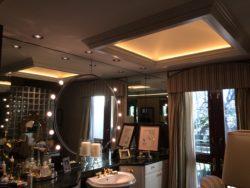 cove lighting in a glamorous residential bathroom