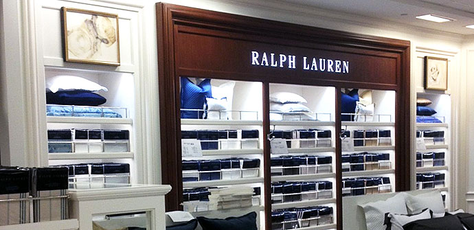 A Ralph Lauren Home display is illuminated by Phantom LED cabinet lighting